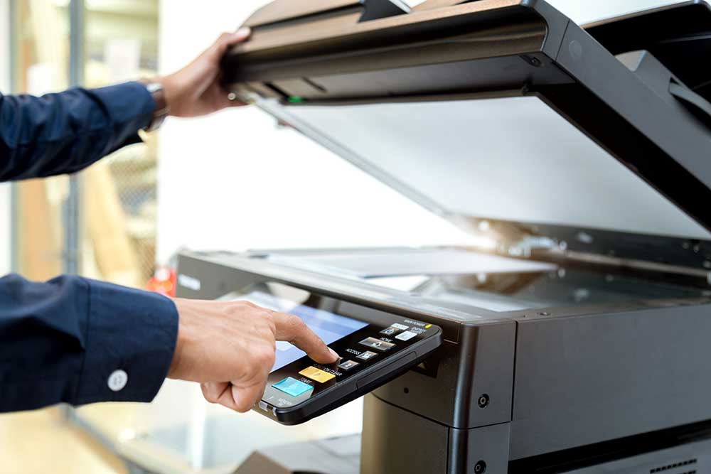 bussiness-man-hand-press-button-panel-printer